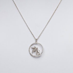 Sterling silver pendant on chain with horse and rider jumping over a fence.