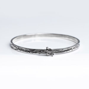 Sterling Silver 4 cm wide textured Bangle with silver hare that can move around the bangle