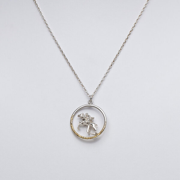 Sterling silver pendant on chain with horse and rider jumpin a fence gold highlight