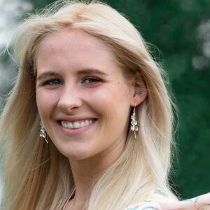 Model wearing Hydrangea dangle earrings