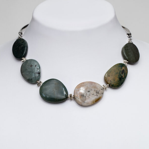 Smooth oval green agate large pebble necklace hanging from a silver hoop