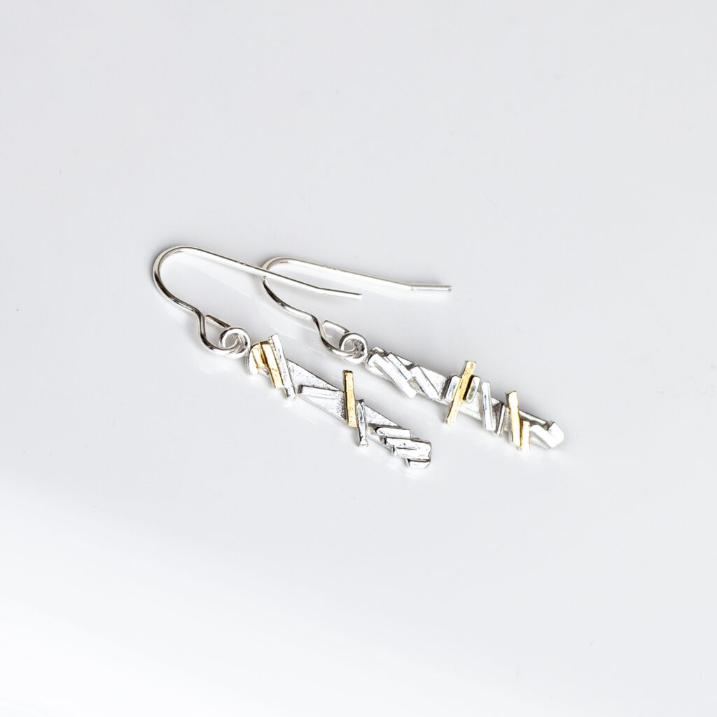 Silver geometric  line dangling earrings with gold highlights