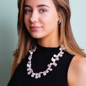 Girl wearing coin freshwater pearls necklace for sale
