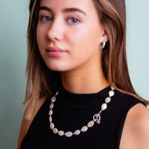 Girl wearing Pearl and garnet necklace