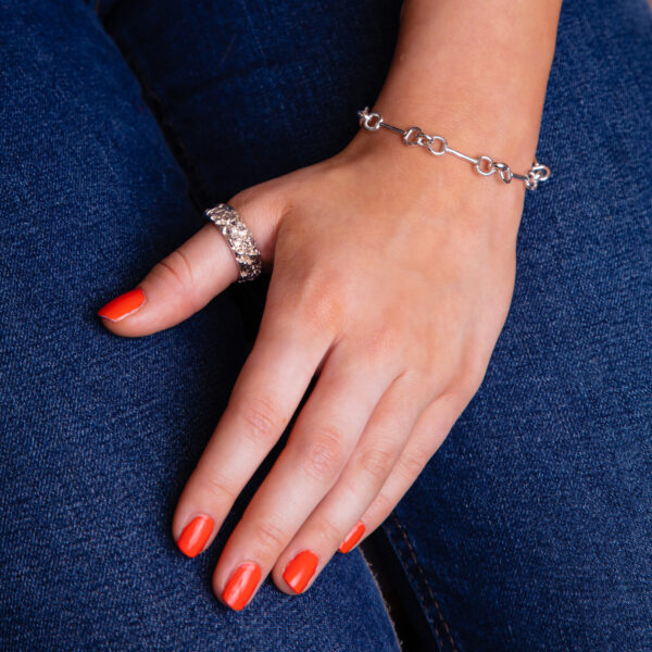 Modal wearing a snaffle bracelet and quince ring