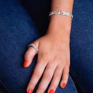 Model wearing handmade Sterling silver bracelet quince textured and ring