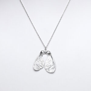 Sterling silver sycamore seed pendant on a chain